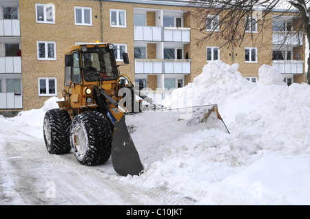 Snow-clearing with loader in Sweden, Scandinavia, Europe - Stock Photo