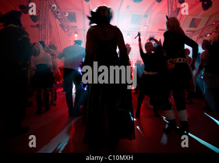 People dancing enjoying nightlife during the Crazy Days of the Carnival in Cologne (Germany) - Stock Photo