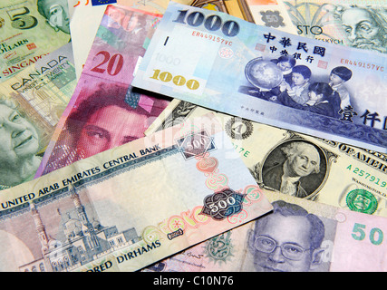 Banknotes in different currencies - Stock Photo