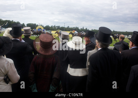 Race goers at the finish line react to the race finish at Royal Ascot race course. - Stock Photo