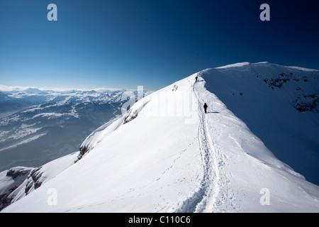Hiker on the ridge on the Chaeserrugg, Churfirsten, Toggenburg, Switzerland, Europe - Stock Photo