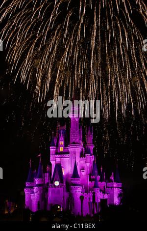 Fireworks over Cinderella castle magic kingdom Disney world Florida - Stock Photo