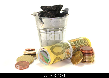 Bucket of coal and euro notes on a white background - Stock Photo