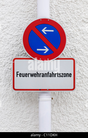 Restricted parking zone sign with additional sign Feuerwehranfahrtszone, please allow room for the fire departement - Stock Photo