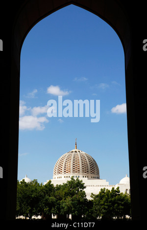 Looking through an arch to the dome of the Sultan Qaboos Grand Mosque in Muscat, Oman. - Stock Photo