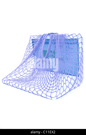 Laptop in a net, symbolic for trapped in a net - Stock Photo