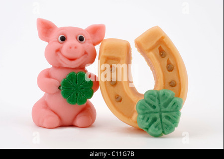 Lucky charm, good luck charm, marzipan, pig, horse shoe, four leaf clover, New Year, New Year's Eve - Stock Photo