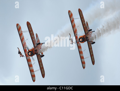 2 bi- planes with wing walkers - Stock Photo