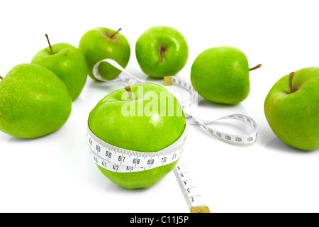 Green apples measured the meter, sports apples - Stock Photo