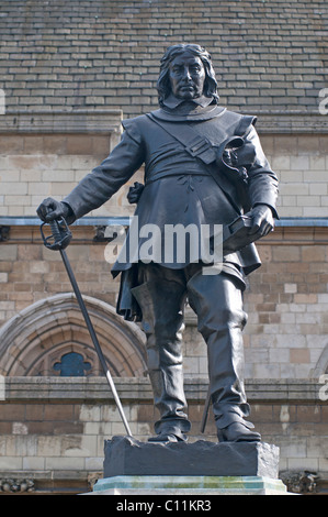 Statue of Oliver Cromwell outside the House of Lords at the Palace of Westminster - Stock Photo
