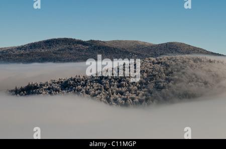 Fog over Velebit (a mountain in Croatia, Europe). A photo was taken during winter time. - Stock Photo