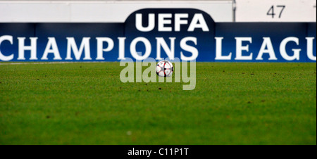 Football in front of UEFA Champions League perimeter advertising boards, Mercedes-Benz Arena, Stuttgart, Baden-Wuerttemberg - Stock Photo