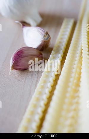 Raw pasta, garlic - Stock Photo