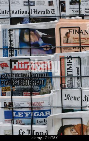 Magazine rack, international newspapers, German, French, Turkish and British press - Stock Photo