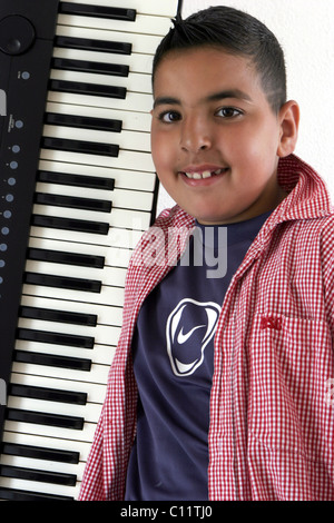 Boy with synthesizer posing - Stock Photo