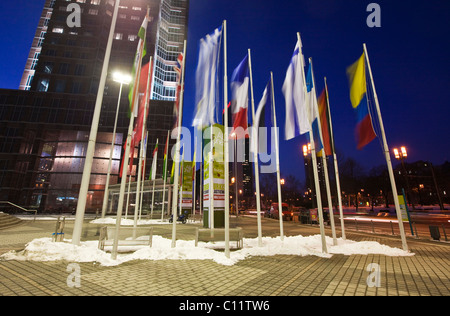 Flags of nations at the main entrance to the Messe Frankfurt Trade Fair, in front of the Messeturm building, Frankfurt, - Stock Photo