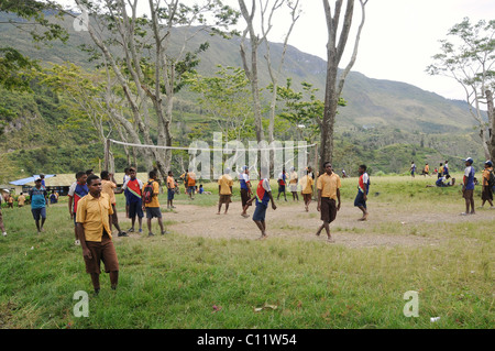 Middle school, students playing volleyball, junior high school, SMP Kurima, Baliem Valley, Irian Jaya, Indonesia, - Stock Photo