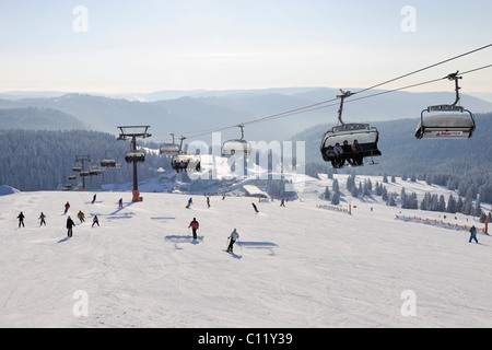 Skilift and skiers on Mt Feldberg, southern Black Forest, Baden-Wuerttemberg, Germany, Europe - Stock Photo