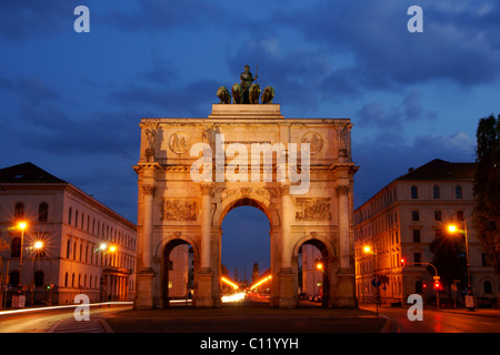 Siegestor, Victory Gate at night in Munich, Bavaria, Germany, Europe - Stock Photo