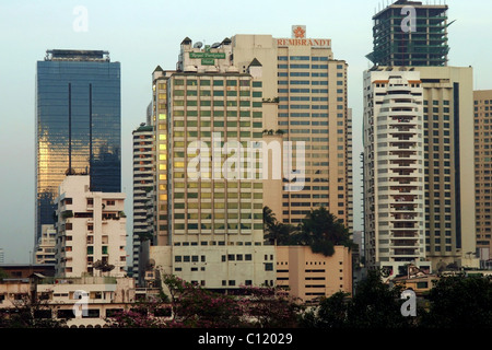 The early morning sun reflects off modern buildings, including The Rembrandt and Royal Parkview hotels in Bangkok, - Stock Photo