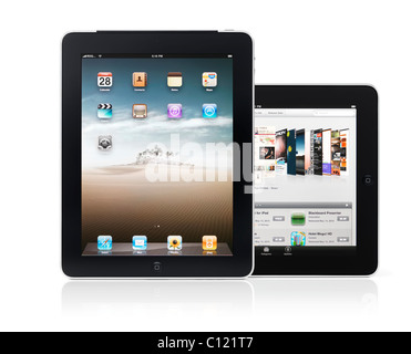 Two Apple iPad 3G tablets isolated on white background with clipping path - Stock Photo