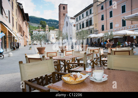 Cappuccino and croissant in the restaurant Gatto Nero, Piazza Carducci, Pietrasanta, Tuscany, Italy, Europe - Stock Photo