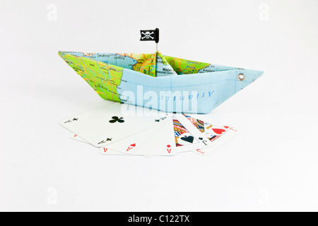 Pirates, pirate ship, playing cards, symbolic image for the hijacking of merchant ships and playing poker for ransom - Stock Photo