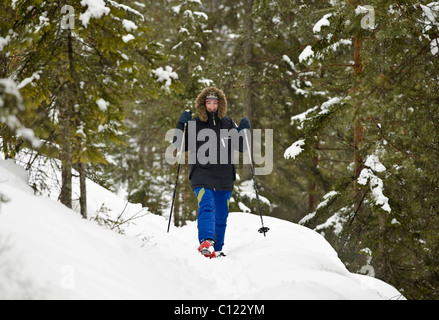 Women walking with snowshoes - Stock Photo