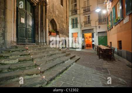Restaurant in a narrow street, Genova, Genoa, Liguria, Italy, Europe - Stock Photo