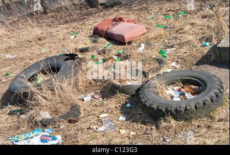 Illegal dumping of tires and garbage causing pollution. - Stock Photo