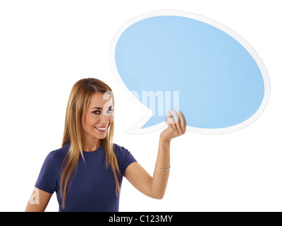 mid adult woman holding blank speech bubble on white background. - Stock Photo
