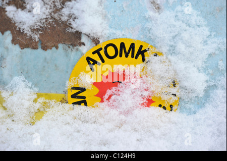 Snow-covered sticker, 'Atomkraft, Nein Danke' nuclear power No thanks - Stock Photo