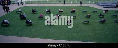 Race goers relax before the start of the races at Royal Ascot Race Course. Royal Ascot is one of the most famous - Stock Photo