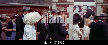 Race goers queue at the entrance to Royal Ascot Race Course. Royal Ascot is one of the most famous race meetings - Stock Photo