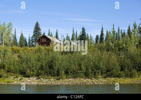 Old trapping cabin, log cabin, up on the river bank, upper Liard River, Yukon Territory, Canada - Stock Photo