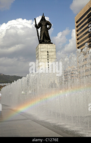 Fountain and rainbow in front of the Admiral Yi Sun Shin statue at Gwanghwamun Plaza in downtown Seoul, South Korea, - Stock Photo