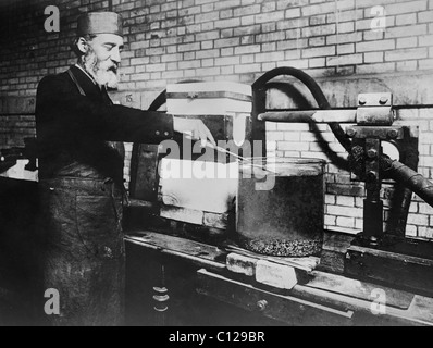 French chemist Henri Moissan (1852 - 1907) - winner of the Nobel Prize in Chemistry in 1906 - attempting to make - Stock Photo