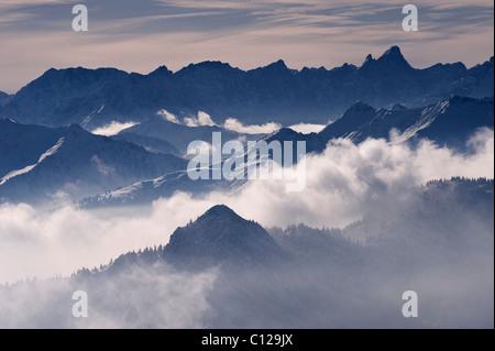Wettersteingebirge mountain range in fog, Bavarian Alps seen from Mt. Wallenberg, Upper Bavaria, Bavaria, Germany, - Stock Photo