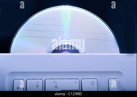 Data cd in a notebook - Stock Photo