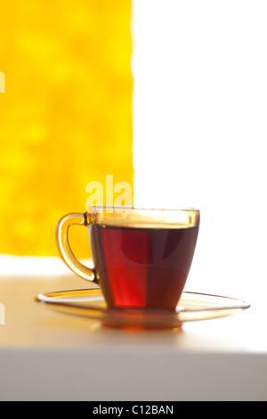 cup of tea next to window, modern minimal look - Stock Photo