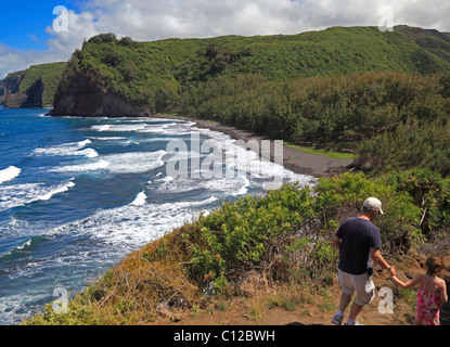Hikers on the Pololu Valley trail on the Big Island