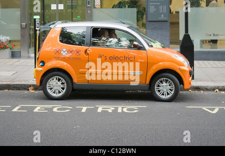 An electric car recharging at an electrobay, London , UK. - Stock Photo