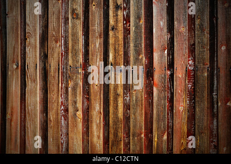 Background of rough wooden panels of an old barn wall - Stock Photo
