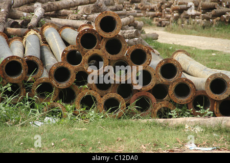 looking through pipe holes - Stock Photo