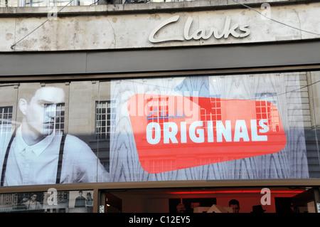 Clarks Originals desert boots suede shoes shop shoe shop logo brand - Stock Photo