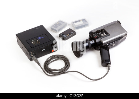 old video camera and portable sVHS video recorder - Stock Photo