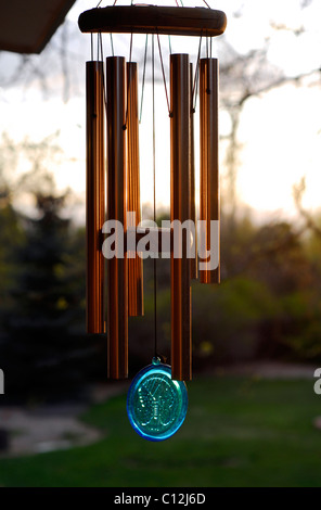 Wind chimes hanging in a back yard during summer season - Stock Photo