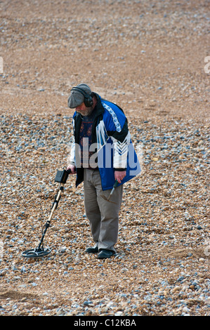 Man On A Beach With A Metal Detector - Stock Photo