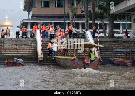 Tourists Boarding Boat on Brunei River - Stock Photo