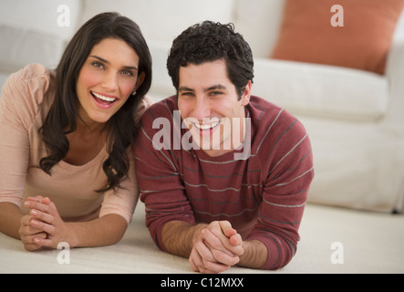 USA, New Jersey, Jersey City, portrait of couple lying on floor - Stock Photo